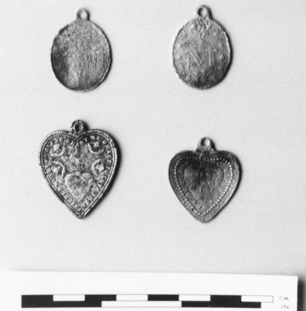 Medallions found with burials at manorhamilton