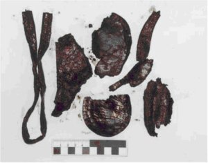 9 Leather fragments including a welt fragment quarter section seat stiffener and heel piece
